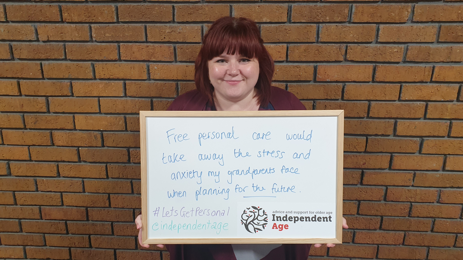Campaigner supporting Independent Age calls with a placard. Image: Independent Age