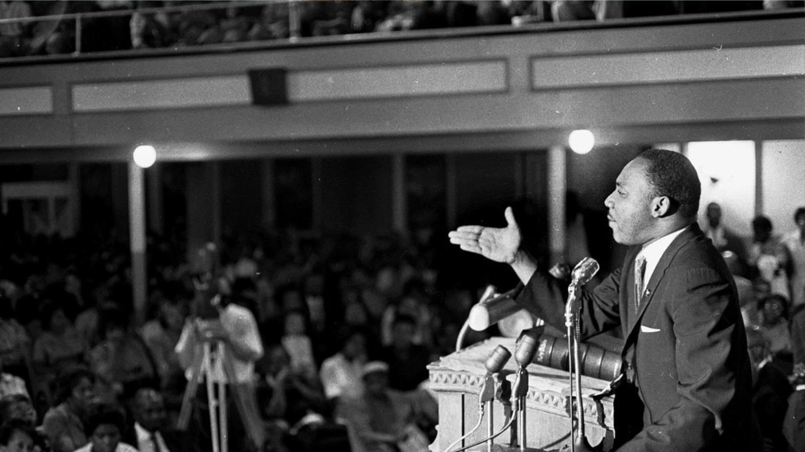Martin Luther King Jr. speaking at River Side Church, to end the conflict in Vietnam; New York City, April 4, 1967. He is standing at a pulpit, hand pointing to the audience. People infront of him listening.
