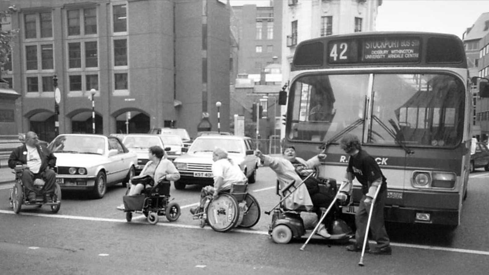 Folks in wheelchairs blocking a bus for disability rights