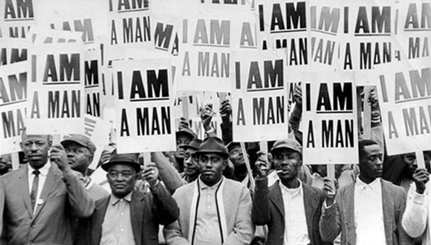 Men holding up posters saying I am a man.