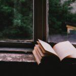 an open book on a windowsill